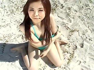 Busty Asian cutie poses in hot bikini and can make anyone jizz
