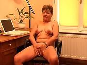 Granny in heat masturbates behind her desk