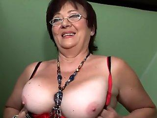 Insatiable mature keeps her stockings on for fucking