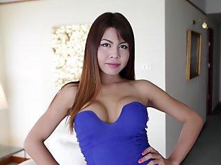 Shy Thai shemale sucks and fucks big white cock