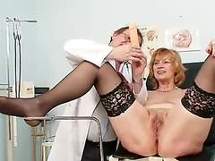 Redhead granny dirty pussy stretching in gyn clinic