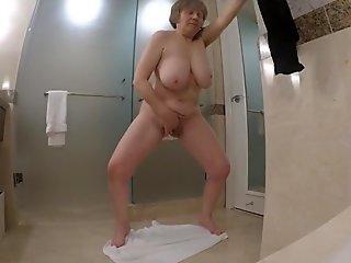 60 GILF masturbates like a ballerina