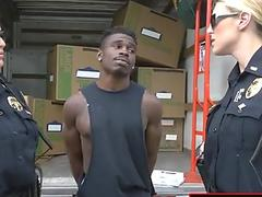 Blonde milf in cop uniform likes to make love hard in all fours with this young black man.