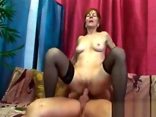 Young guy relentlessly fucks sex-crazed granny in black stockings