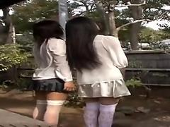 Two steamy Japanese chicks Yukari Nakai and her group fellow are posing on cam