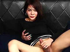 Sultry asian tgirl shows off her ass and cock
