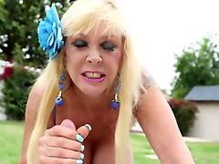 Gilf outdoor titfucked in between huge boobs
