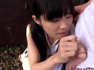 Tiny Japanese honey nailed between gams outdoors