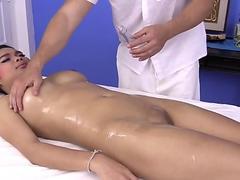 Big boob Asian girl finger fucked on massage table