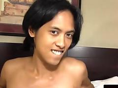 Asian femboy solo jerking her candy stick