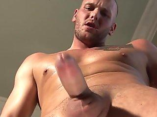 Inked euro stud solo tugging in closeup