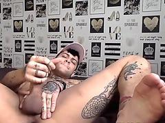 Sexy tattooed hunk Mickey Taylor wanking his fat cock