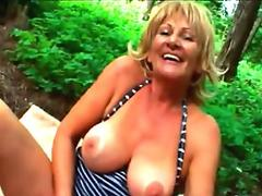 Granny sucks cock and gets fucked in the bushes