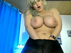 Chubby blonde chick teases with her big tits