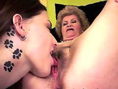 Busty gilf eaten out by tattooed lesbian