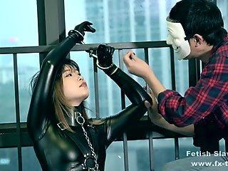 bondage leather catsuit female on single gloves