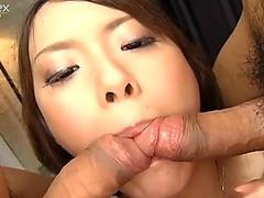 Pig tailed Japanese girl Yuri Kousaka swallows two dicks at a time